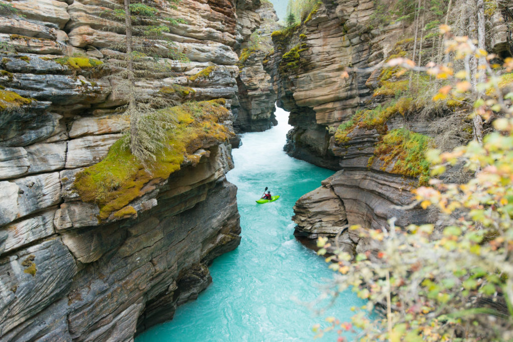 Kayaker down Athabasca Canyon, Jasper National Park, Alberta, Canada
