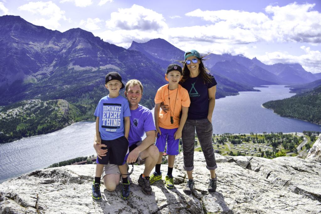 Family on top of Bear's Hump, Waterton, Alberta, Canada
