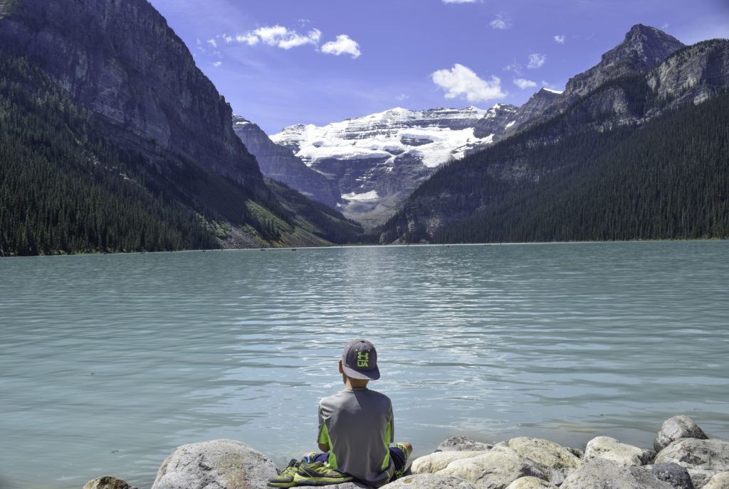 Kid overlooking Lake Louise, Banff Alberta Canada
