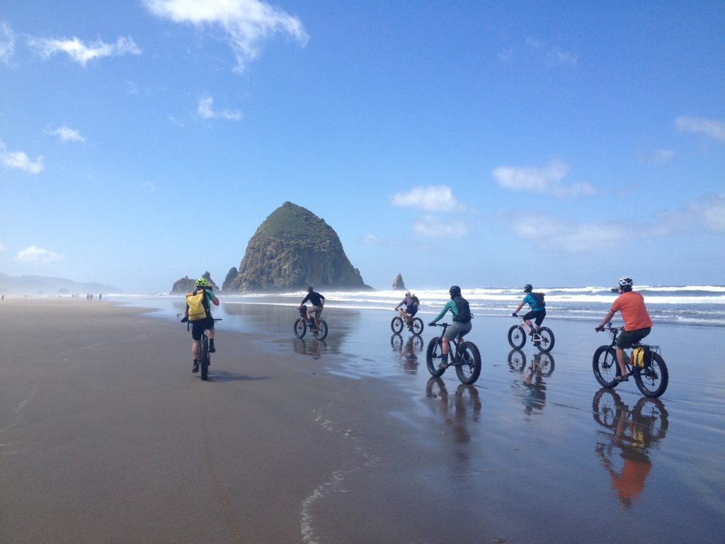 Fat biking on the beach of Cannon Beach, Oregon.