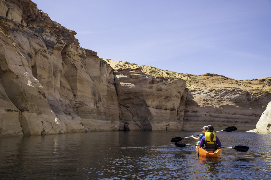 Kayaking through Lower Antelope Canyon at Lake Powell, near Paige, Arizona