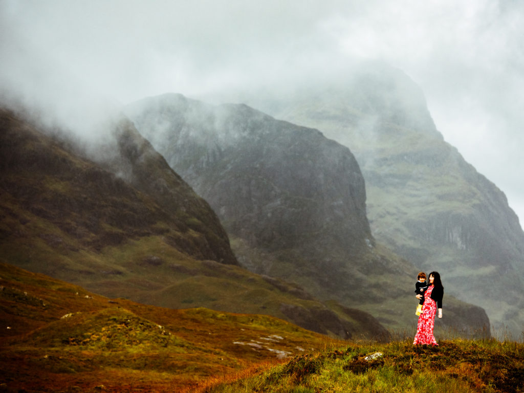 Woman and child in Glencoe, Scotland mountains